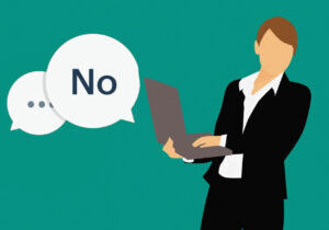 """A person at work with a speech bubble saying """"no"""""""